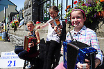 Buskers Riona and Charlotte Hulme with Maria O'Sullivan from Caherdaniel, County Kerry pictured taking part in the Celtic Music Festival busking competition in Cahersiveen, County Kerry at the weekend.<br /> Picture by Don MacMonagle