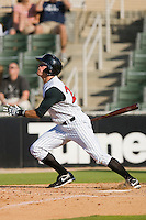 Nicholas Ciolli #20 of the Kannapolis Intimidators follows through on his swing against the against the Rome Braves at Fieldcrest Cannon Stadium April 11, 2010, in Kannapolis, North Carolina.  Photo by Brian Westerholt / Four Seam Images