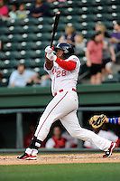 Left fielder Carlos Mesa (28) of the Greenville Drive bats in a game against the Lexington Legends on Tuesday, April 14, 2015, at Fluor Field at the West End in Greenville, South Carolina. Lexington won, 5-3. (Tom Priddy/Four Seam Images)
