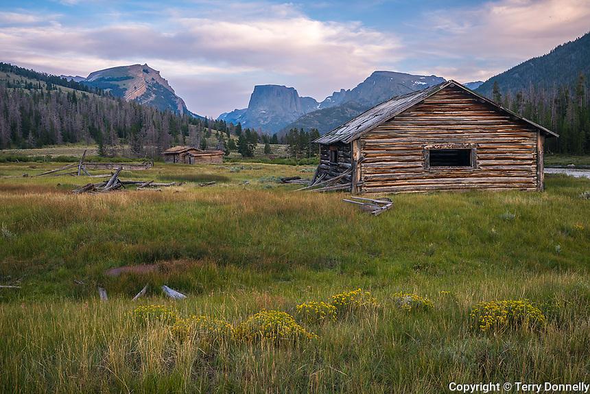 Bridger-Teton National Forest, Wyoming:<br /> Abandoned log cabins under the profile of the Wind River range