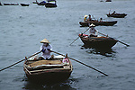 Rowing boats on Halong Bay