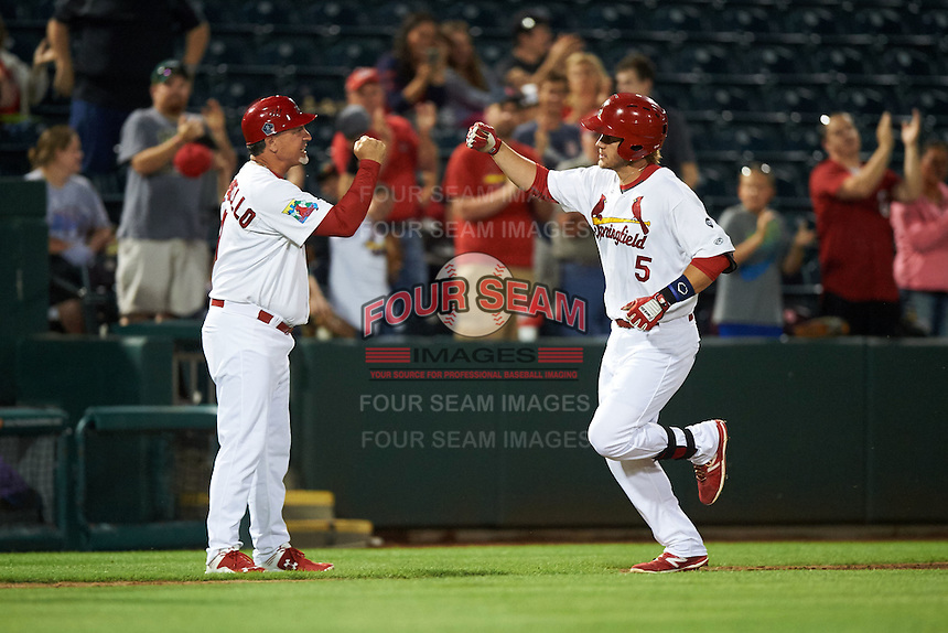 Springfield Cardinals third baseman Patrick Wisdom (5) fist bumps manager Dann Bilardello (11) after hitting a home run during a game against the Frisco RoughRiders  on June 3, 2015 at Hammons Field in Springfield, Missouri.  Springfield defeated Frisco 7-2.  (Mike Janes/Four Seam Images)