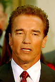 Washington, DC - October 29, 2009 -- California Governor-elect Arnold Schwarzenegger meets reporters in the United States Capitol in Washington, DC on October 29, 2003.  He was meeting with the U.S. House Republican Conference to discuss ways to bring more money to California to help eliminate its financial crisis..Credit: Ron Sachs / CNP