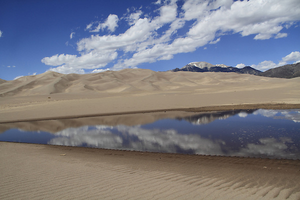 Oasis and Medano Creek in Great Sand Dunes National Park with Sangre de Cristo Range, Colorado. John offers private photo tours to Great Sand Dunes National Park and Rocky Mountain National Park, Colorado.