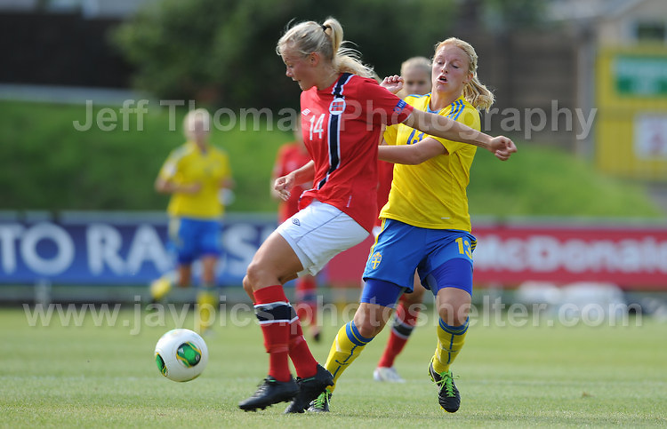 Guro Bergsvand of Norway battles with Mimmi Larsson of Sweden during the UEFA Womens U19 Championships at Stebonheath park Sunday 25th August 2013. All images are the copyright of Jeff Thomas Photography-www.jaypics.photoshelter.com-07837 386244-Any use of images must be authorised by the copyright owner.