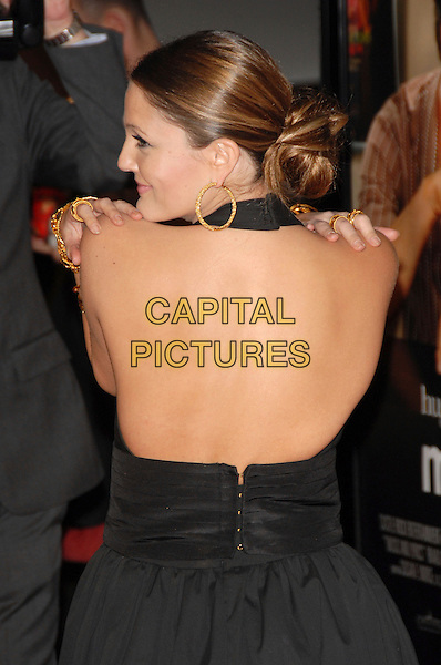 "DREW BARRYMORE.The Warner Brother Pictures' World Premiere of ""Music and Lyrics"" to Benefit NRDC held at The Grauman's Chinese Theatre in Hollywood, California, USA..Februay 7th, 2007.half length black dress halterneck gold earrings jewellery jewelry backless profile hair bun back behind rear.CAP/DVS.©Debbie VanStory/Capital Pictures"