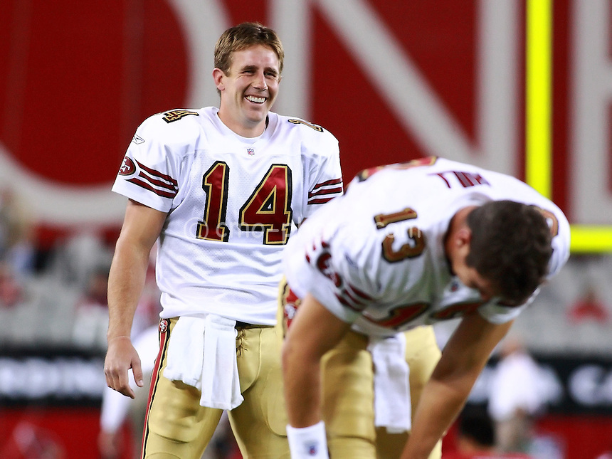 Nov 10, 2008; Glendale, AZ, USA; San Francisco 49ers quarterback J.T. O'Sullivan (14) laughs with fellow quarterback Shaun Hill (13) prior to a Monday Night Football game against the Arizona Cardinals at University of Phoenix Stadium.  The Cardinals won the game 29-24.