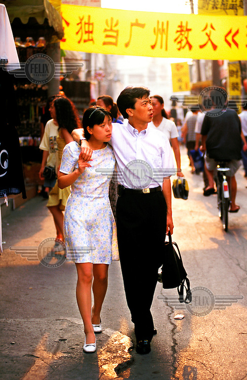 Mark Henley/Panos Pictures..China, Beijing..Couple out shopping.