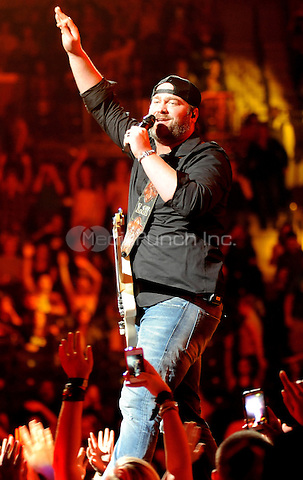 "New York, NY-September14:  Lee Brice performs on stage as part of the 2014 ""That's My Kind Of Night Tour"" on September 14, 2014 at the Barclays Center in Brooklyn, New York.Credit: John Palmer/MediaPunch"
