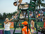 March 26 2016: Timea Bacsinszky (SUI), shakes hands with chair umpire after winning at the Miami Open being played at Crandon Park Tennis Center in Miami, Key Biscayne, Florida.