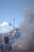 People are watching to explosion of tens of meters long firecrackers in the city.....End of year 2010 celebrations on the streets of Paramaribo. Suriname is one of biggest consumer in South America that using firecrackers, fireworks ( also locally known as pagara ) for celebrations, especially for end of every years and also beginning of every new Chinese Years.
