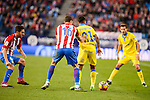 Atletico de Madrid Koke Resurrección and Sime Vrsaljko and UD Las Palmas Jonathan Viera and Helder Lopes during La Liga match between Atletico de Madrid and UD Las Palmas at Vicente Calderon Stadium in Madrid, Spain. December 17, 2016. (ALTERPHOTOS/BorjaB.Hojas)