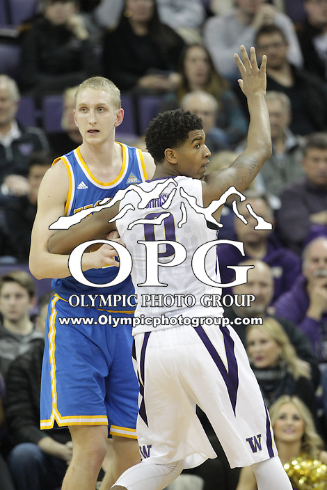 JAN 1, 2016:  Washington's #0 Marquese Chriss boxes out UCLA's #44 Jonah Bolden under the basket.  Washington defeated #25 ranked UCLA 96-93 in double overtime at Alaska Airlines Arena in Seattle, WA.