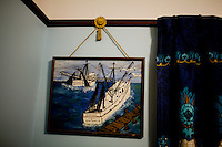 Artwork reminds visitors of Grand Isle's rich shrimping industry.  Before the Deepwater Horizon Spill, the area hosted one of the worlds most productive fisheries; many areas are currently and indefinitely closed to fishing...Photographs from Grand Isle and surrounding areas impacted by the Deepwater Horizon Oil Spill.  The spill is estimated to be gushing 35,000 to 60,000 barells of oil into the ocean per day.  Difficulties installing monitoring devices at the source have made this number difficult to clearly ascertain.  The spill is among the world's worst.