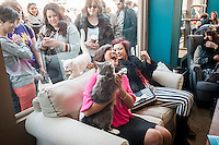 Celebrity dancer and cat lover Carrie Ann Inaba, center, at the Cat Cafe on the Bowery in New York on its grand opening day, Thursday, April 24, 2014. Purina has teamed with the North Shore Animal League to open the pop-up cafe where cat aficionados are not afraid to get a little fur on their clothing while they snuggle the adoptable cats, drink cappuccino and eat pastries. The kitties are free-range around the store and the customers can pet them, pick them up and play with them. Cat cafes are already big in Japan and this pop-up store is a first for New York. The event only goes until April 27 when you can take your adopted kittie home. (© Richard B. Levine)