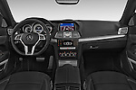Stock photo of straight dashboard view of a 2015 Mercedes Benz E Class AMG Line 2 Door Convertible 2WD Dashboard