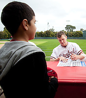 STANFORD, CA - March 27, 2011: Chris Reed of Stanford baseball signs an autograph after Stanford's game against Long Beach State at Sunken Diamond. Stanford won 6-5.