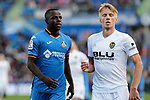 Getafe CF's Amath Ndiaye and Valencia CF's Daniel Wass during La Liga match between Getafe CF and Valencia CF at Coliseum Alfonso Perez in Getafe, Spain. November 10, 2018.
