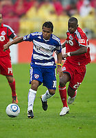 July 24, 2010  FC Dallas midfielder/forward David Ferreira #10 and Toronto FC midfielder Amadou Sanyang #22 in action during a game between FC Dallas and Toronto FC at BMO Field in Toronto..Final score was 1-1.