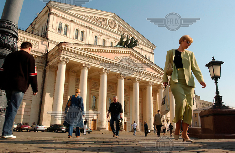 Muscovites pass the Bolshoi theatre on their way to work.
