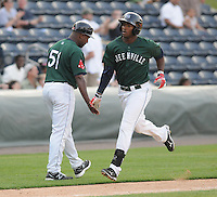 Outfielder Brandon Jacobs (24) of the Greenville Drive is congratulated by manager Billy McMillon after hitting a home run in a game against the Augusta GreenJackets on April 10, 2011, at Fluor Field at the West End in Greenville, South Carolina. (Tom Priddy / Four Seam Images)