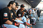 SF Giants' Angel Pagan and teammates talk at the start of a spring training game in Peoria, Ariz., on Wednesday, March 16, 2016. <br />