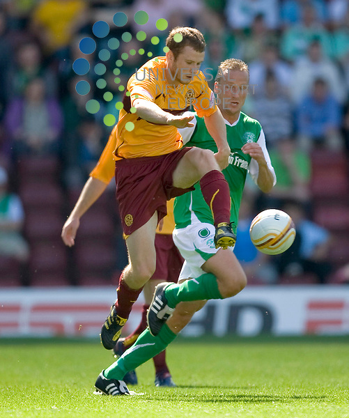 Well's Mark Reynolds(4) in action during The Clydesdale Bank Premier League match between Motherwell and Hibernian at Fir Park 15/08/10..Picture by Ricky Rae/universal News & Sport (Scotland).