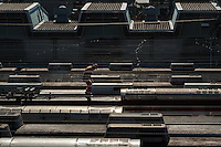 A mechanic walks on the roof of train carriages on the Tokyu Den-en-toshi Line at the Tokyu train yard in Tsukushino, Tokyo, Japan Saturday December 27th 2014