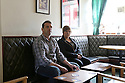 TO GO WITH IAN COBAIN FEATURE - JOB BOOKED BY GUY LANE:  Aidan O'Toole a  survivor of the 1994 gun attack, and Emma Rogan the daughter of Adrian Rogan a victim who was murdered by Loyalist gunmen in 1994 attack sit inside the same room where the gun attack took place in the Bar as it is today. (2 Oct 2012). O'Tooles Bar is the only Pub in the small village of Loughinisland in County Down, Northern Ireland. On 18 June 1994 and The Ulster Volunteer Force (UVF), a loyalist paramilitary group, attacked the crowded pub with assault rifles killing six civilians and wounding five. The pub was targeted because those inside were believed to be Catholics. Photo/Paul McErlane