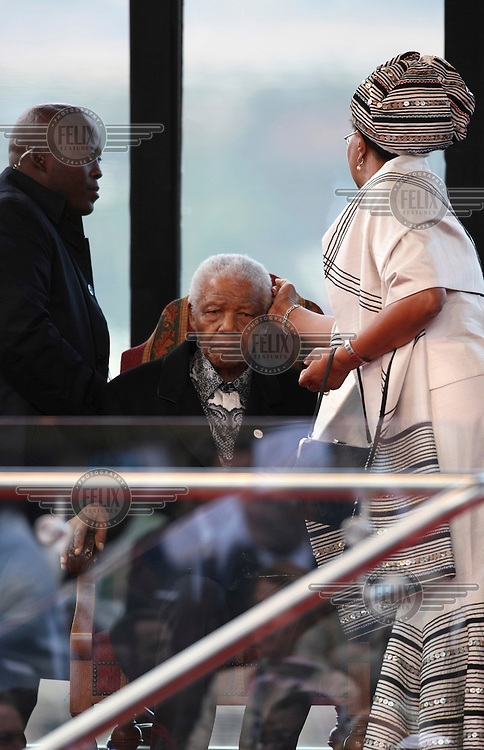 Graca Machel, wife of former South African President Nelson Mandela, touches his face at the inauguration ceremony of Jacob Zuma in Pretoria. Zuma is the fourth democratically elected president of South Africa.