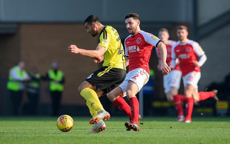 Fleetwood Town's Lewis Coyle vies for possession with Burton Albion's Colin Daniel<br /> <br /> Photographer Chris Vaughan/CameraSport<br /> <br /> The EFL Sky Bet League One - Saturday 23rd February 2019 - Burton Albion v Fleetwood Town - Pirelli Stadium - Burton upon Trent<br /> <br /> World Copyright © 2019 CameraSport. All rights reserved. 43 Linden Ave. Countesthorpe. Leicester. England. LE8 5PG - Tel: +44 (0) 116 277 4147 - admin@camerasport.com - www.camerasport.com