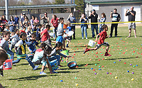 NWA Democrat-Gazette/FLIP PUTTHOFF <br />SCRAMBLE FOR EGGS<br />A young egg hunter leads the pack, sprinting through a field of Easter eggs on Saturday March 24 2018 during the Mayor's Easter Egg Hunt in Rogers at Veterans Park. Youngsters 9 and under picked up 11,000 plastic eggs filled with prizes during the Easter egg hunt. Acttivies also included an inflatable playground and an array of games for kids.