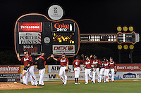 Nashville Sounds players congratulate each other after the second game of a double header against the Omaha Storm Chasers on May 22, 2014 at Herschel Greer Stadium in Nashville, Tennessee.  Nashville defeated Omaha 13-4.  (Mike Janes/Four Seam Images)