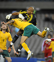 MELBOURNE, AUSTRALIA - OCTOBER 14: Tim Cahill from Australia contests for the ball against Ali Habsi from Oman in a AFC Asian Cup 2011 match between Australia and Oman at Etihad Stadium on October 14, 2009 in Melbourne, Australia. Photo Sydney Low www.syd-low.com