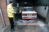 Traffic police officers washing their police rapid response traffic vehicle...© SHOUT. THIS PICTURE MUST ONLY BE USED TO ILLUSTRATE THE EMERGENCY SERVICES IN A POSITIVE MANNER. CONTACT JOHN CALLAN. Exact date unknown.john@shoutpictures.com.www.shoutpictures.com..