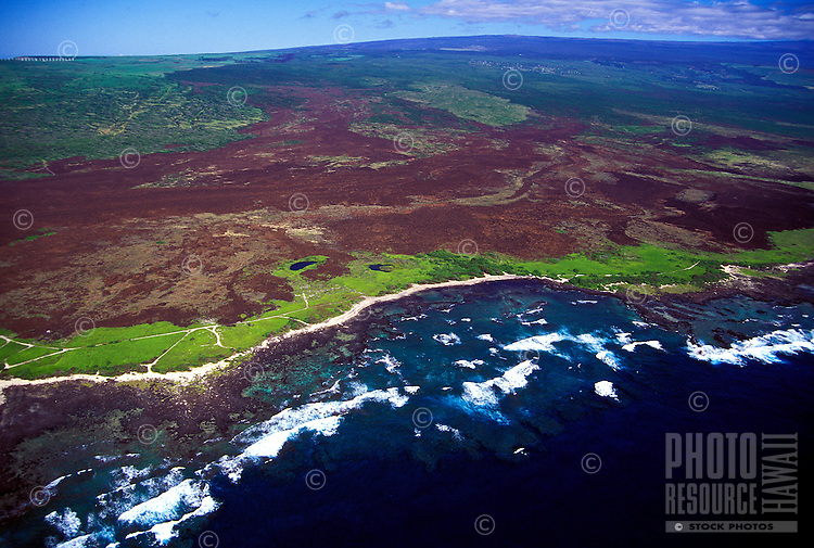 Aerial of the lush green coast of the Big Island of Hawaii known as South Point.