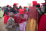 OTJIWARONGO, NAMBIA- AUGUST 12: A Herero elder spits water in the faces of newly arrived Herero women  during a march when commemorating fallen chiefs killed in battles with Germans. The blessing ceremony is held to welcome the arrival of the members of the community. The area was the venue for decisive battles of the Herero uprisings in 1904. The Herero accuse the German Empire of Genocide of its people from 1904-07. They are currently trying to make the German government compensate the descendants of the people killed. (Photo by Per-Anders Pettersson)