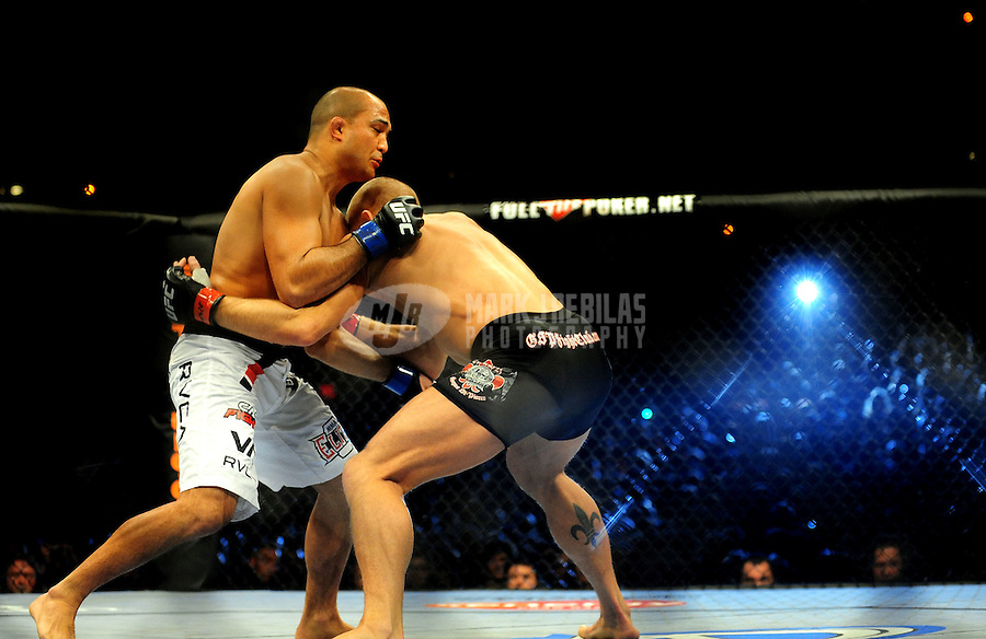 Jan. 31, 2009; Las Vegas, NV, USA; UFC fighter B.J. Penn (white trunks) against Georges St-Pierre (black trunks) during the welterweight championship in UFC 94 at the MGM Grand Hotel and Casino. St-Pierre defeated Penn with a fourth round TKO. Mandatory Credit: Mark J. Rebilas-
