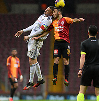 15th March 2020, Istanbul, Turkey;  Burak Yilmaz of Besiktas and Marcelo Saracchi of Galatasaray challenge for a header during the Turkish Super league football match between Galatasaray and Besiktas at Turk Telkom Stadium in Istanbul , Turkey on March 15 , 2020.