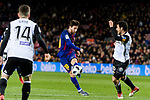 Lionel Messi of FC Barcelona (L) attempts a kick while being defended by Daniel Parejo Munoz of Valencia CF (R) during the Copa Del Rey 2017-18 match between FC Barcelona and Valencia CF at Camp Nou Stadium on 01 February 2018 in Barcelona, Spain. Photo by Vicens Gimenez / Power Sport Images
