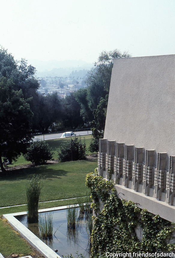 Frank Lloyd Wright:  Hollyhock House, Hollywood, 1917.  Sloped concrete with flat roof.  Hollyhock motif.   Photo 1982.