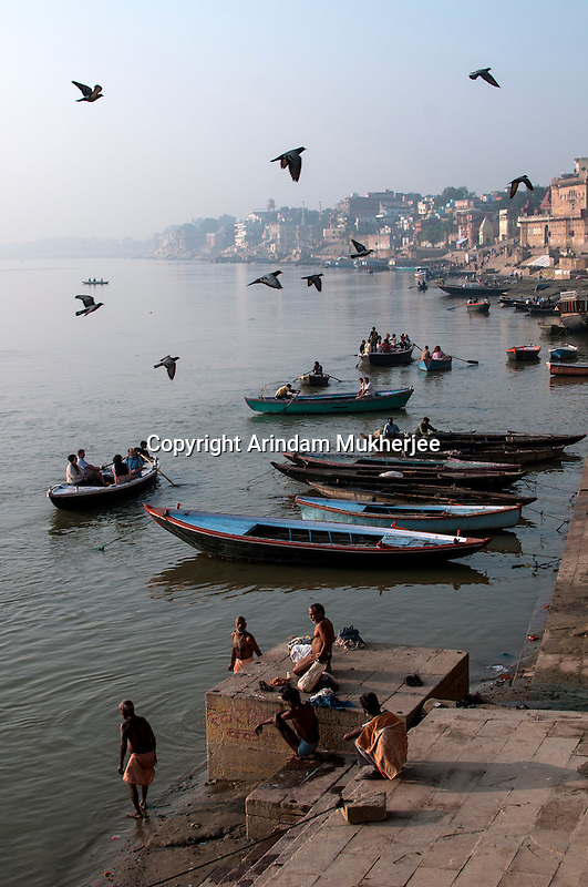 Indian men in their daily chore at a ghat in Varanasi, Uttar Pradesh, India.