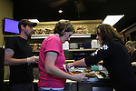 From left, Chaz and Nicky double check a lunch order for Kimberly Weaver, wife of owner Judy Weaver. Photo by Alex Holt