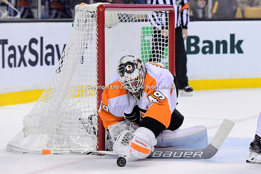 March 8, 2018: Philadelphia Flyers goaltender Alex Lyon (49) covers the puck during the NHL game between the Philadelphia Flyers and the Boston Bruins held at TD Garden, in Boston, Mass. Boston defeats Philadelphia 3-2 in regulation time. Eric Canha/CSM