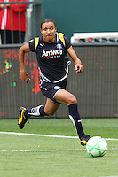 Marta #10 of the Los Angeles Sol attacks the defense of St. Louis Athletica during their WPS game at Home Depot Center on May 30, 2009 in Carson, California. LA Sol defeated  St. Louis Athletic 2-0.