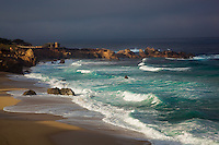 Garrapata State Park, CA<br /> Light breaking through morning cloud cover onto beach and breaking waves