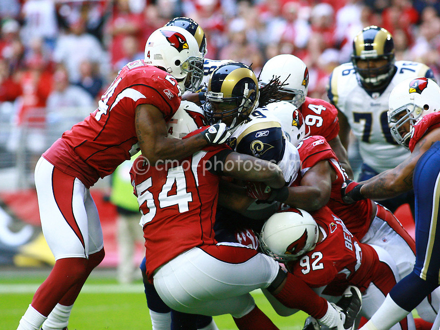 Dec 07, 2008; Glendale, AZ, USA; St. Louis Rams running back Steven Jackson (39) is gang tackled by the Arizona Cardinals defense in the second quarter of a game at University of Phoenix Stadium.  The Cardinals won the game 34-10 to clinch the NFC West division title.  Mandatory Credit: Chris Morrison-US PRESSWIRE