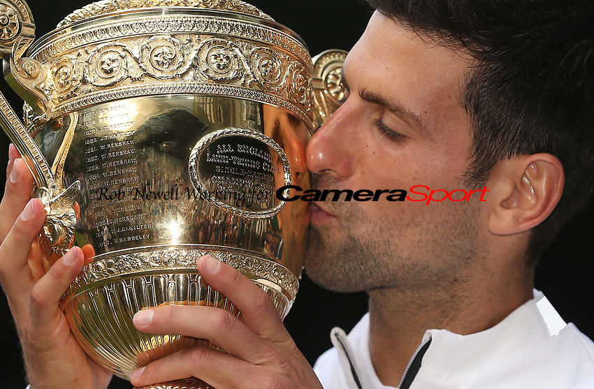 Novak Djokovic (SRB) with the trophy after winning his match against Roger Federer (SUI) in their Gentleman's Singles Final match<br /> <br /> <br /> Photographer Rob Newell/CameraSport<br /> <br /> Wimbledon Lawn Tennis Championships - Day 13 - Sunday 14th July 2019 -  All England Lawn Tennis and Croquet Club - Wimbledon - London - England<br /> <br /> World Copyright © 2019 CameraSport. All rights reserved. 43 Linden Ave. Countesthorpe. Leicester. England. LE8 5PG - Tel: +44 (0) 116 277 4147 - admin@camerasport.com - www.camerasport.com