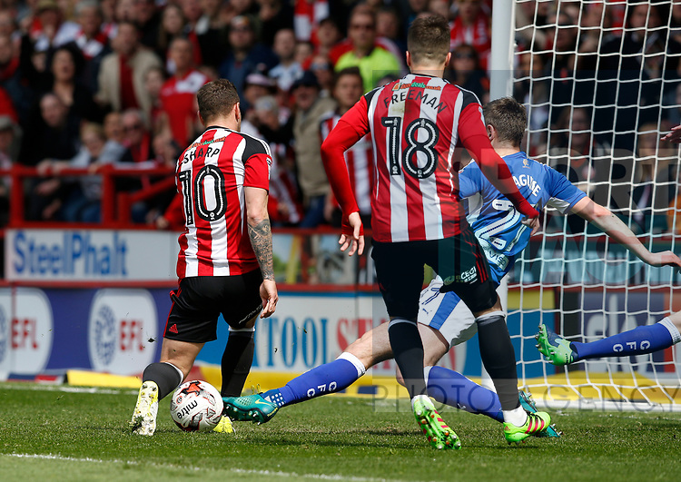 Billy Sharp of Sheffield Utd has his shot blocked by Lawerence Maguire as Kieron Freeman of Sheffield Utd waits to pounce during the English League One match at  Bramall Lane Stadium, Sheffield. Picture date: April 30th 2017. Pic credit should read: Simon Bellis/Sportimage