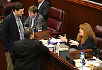 From left, Nevada Assemblymen David Gardner and John Moore, both R-Las Vegas, talk with Assemblywoman Ellen Spiegel, D-Henderson, on the Assembly floor at the Legislative Building in Carson City, Nev., on Monday, April 6, 2015. <br /> Photo by Cathleen Allison